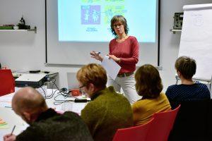 In actie met uitleg over scrum in de communicatiepraktijk